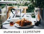 breakfast with croissants and... | Shutterstock . vector #1119557699