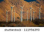 A Group Of Wind Turbines Or...