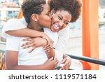 happy young mother having fun... | Shutterstock . vector #1119571184