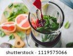man cooking healthy detox... | Shutterstock . vector #1119575066