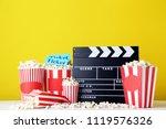 clapper board with popcorn in... | Shutterstock . vector #1119576326