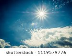blue sky with clouds and sun... | Shutterstock . vector #1119579776