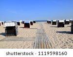 beautiful white sand beach with ... | Shutterstock . vector #1119598160
