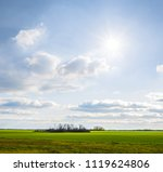 green summer field landscape at ... | Shutterstock . vector #1119624806