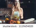 young woman cooking. healthy... | Shutterstock . vector #1119654020