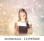 Happy Blond Girl Opening a Gift Box - stock photo