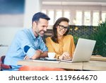 joyful couple using laptop... | Shutterstock . vector #1119664670