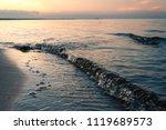 sea waves on the sandy beach in ...   Shutterstock . vector #1119689573