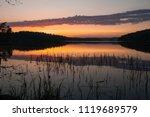 beautiful sunset on the lake....   Shutterstock . vector #1119689579