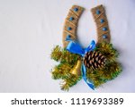 Horseshoe with a bell on the wall, Christmas, new year. - stock photo