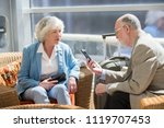senior couple of tourists... | Shutterstock . vector #1119707453