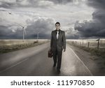 A Young Businessman Walking On...