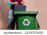 man throwing old car battery in ... | Shutterstock . vector #1119737633