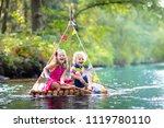 two children on wooden raft...   Shutterstock . vector #1119780110