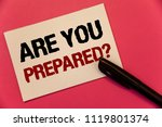 Small photo of Text sign showing Are You Prepared Question. Conceptual photo Ready Preparedness Readiness Assessment Evaluation Text two Words notes written note paper black pen message pink background.