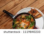 tasty and healthy shakshuka in... | Shutterstock . vector #1119840233
