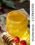 open glass jar of liquid honey... | Shutterstock . vector #1119845300