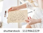girl writes a letter to her... | Shutterstock . vector #1119862229