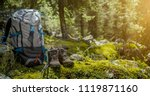 backpack and hiking boots in... | Shutterstock . vector #1119871160