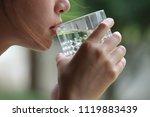 close  up  water drink in  hand | Shutterstock . vector #1119883439