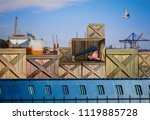 Small photo of Woman talking on phone while in a cargo container