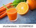 carrot and orange fresh juice... | Shutterstock . vector #1119899810
