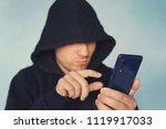 faceless unrecognizable hooded... | Shutterstock . vector #1119917033