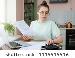 yong woman budgeting  managing... | Shutterstock . vector #1119919916