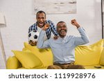 excited father and son with...   Shutterstock . vector #1119928976