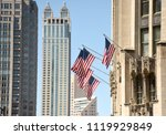 american flag on a building in... | Shutterstock . vector #1119929849