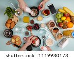 delicious breakfast. young... | Shutterstock . vector #1119930173