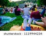people watching movie in open... | Shutterstock . vector #1119944234