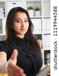 Small photo of young beautiful brunette chinese businesswoman work in office lend hand ahead