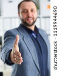 Small photo of young handsome promising businessman work in office lend hand ahead closeup