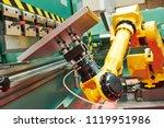 robotics in hydraulic press... | Shutterstock . vector #1119951986