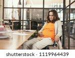 discomfort of pregnancy.... | Shutterstock . vector #1119964439