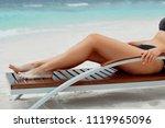 sexy suntan bikin woman legs...   Shutterstock . vector #1119965096