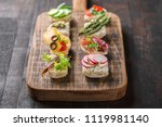 set of different mini canapes... | Shutterstock . vector #1119981140