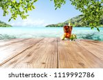 fresh summer drink on desk and... | Shutterstock . vector #1119992786