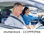 instructor of driving school... | Shutterstock . vector #1119992966