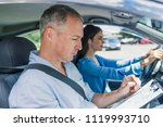 driving instructor and woman... | Shutterstock . vector #1119993710