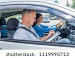 driving instructor and woman... | Shutterstock . vector #1119993713