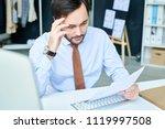 stylish man looking pensive... | Shutterstock . vector #1119997508