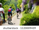 sportive middle age man cycling ... | Shutterstock . vector #1120009439