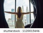 young woman opens the window... | Shutterstock . vector #1120015646