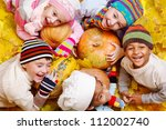 Kids Group On Yellow Leaves An...