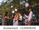 guests with smartphones taking...   Shutterstock . vector #1120028240