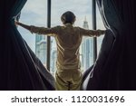 young man opens the window... | Shutterstock . vector #1120031696