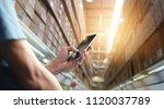factory worker using... | Shutterstock . vector #1120037789