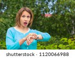 young woman looks at the clock...   Shutterstock . vector #1120066988